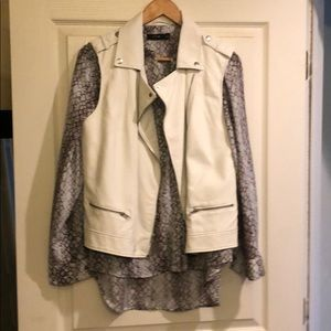 White faux leather vest with silver hardware